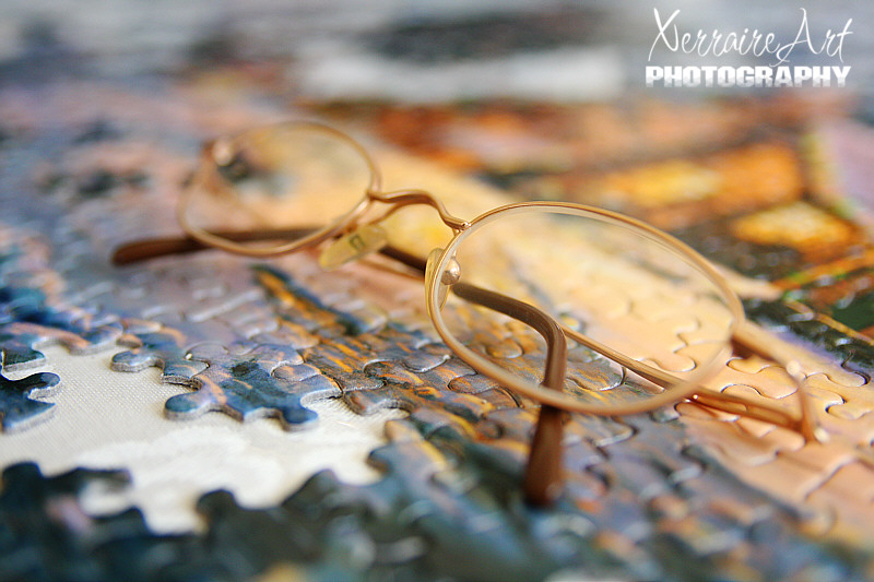 jigsaw puzzle and glasses