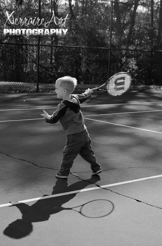 Silas's first tennis lesson.