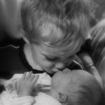 Silas kissing baby sister Rubi
