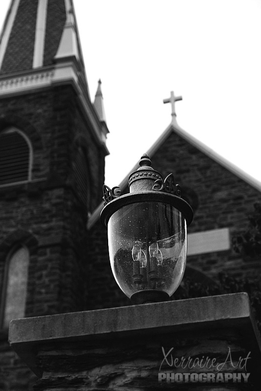 Black and white of an old time lamp at Harpers Ferry
