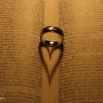 Classic wedding ring in a bible shot
