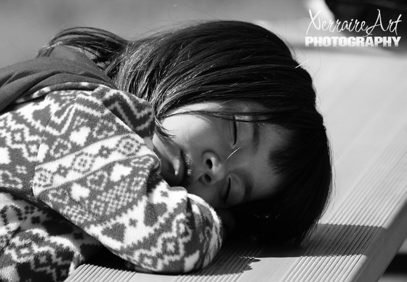 little girl asleep at the park sleeping beauty