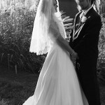 Nicole and Nick in the tall grass Black and White Wedding